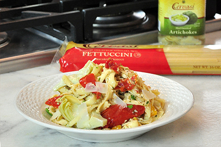 Plate of fettuccini pasta salad on kitchen counter