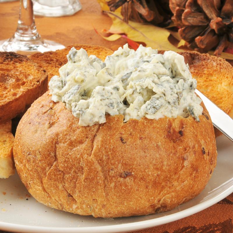 Artichoke dip inside a bread bowl