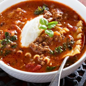 Slow-cooker lasagna soup in a bowl with spoon
