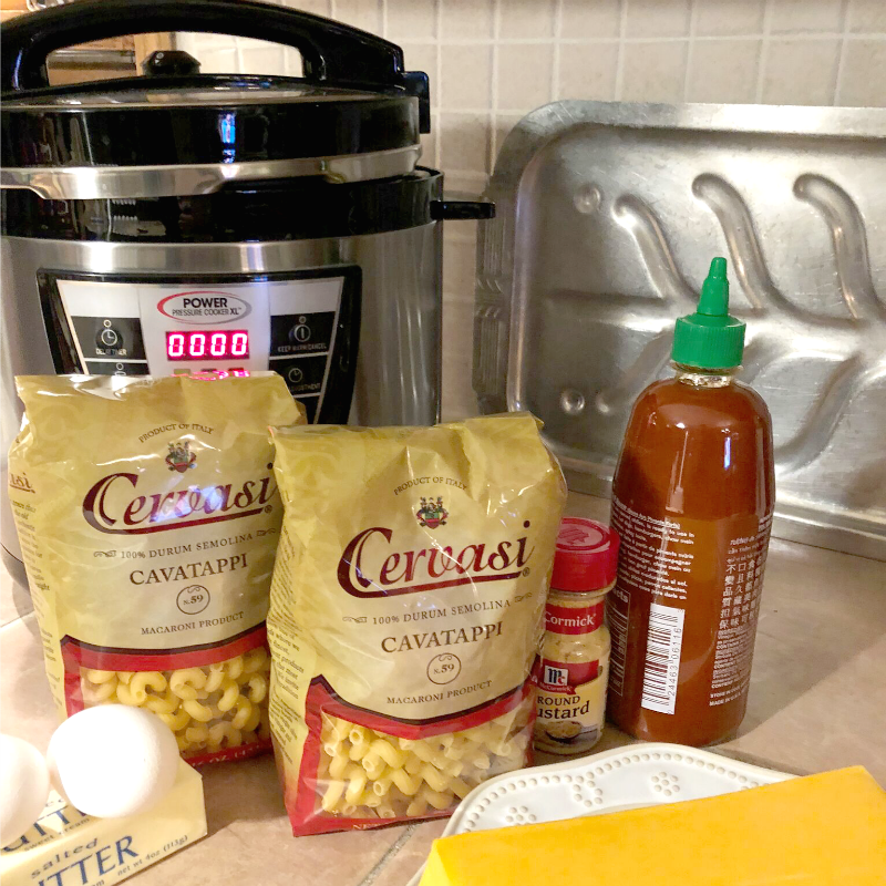 Ingredients on counter to make instant pot macaroni and cheese