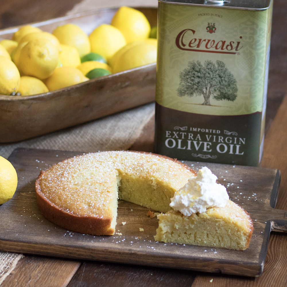 Olive oil cake with slice on top of cutting board